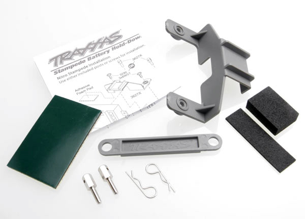 Battery hold-down (grey) (1) / receiver hold-down (grey) (1) / metal posts (2)/ spacers (2)/ body clips (2)/ servo tape/ adhesive foam pad